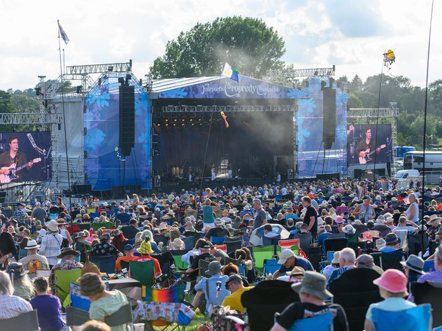 Fans watch Tors perform at Fairport's Cropredy Convention in 2019. Photo by David Jackson
