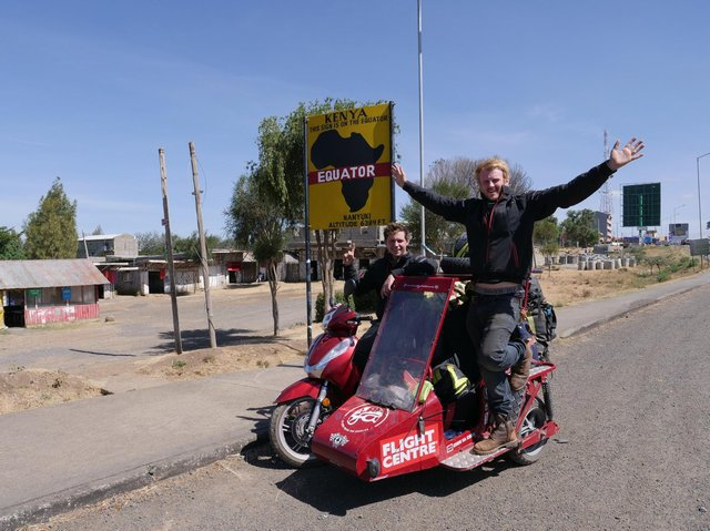 Matt Bishop, from Sibford Ferris, and Reece Gilkes, from Banbury, broke the Guinness World Record for the longest journey on scooter with a sidecar with a monumental 34,000-mile-long trip around the world. (photo taken at the Equator in Kenya)