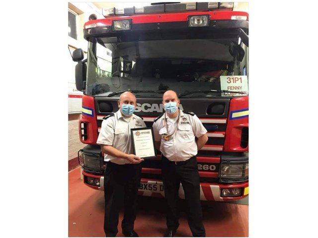 Watch Manager Tony Thornton of Fenny Compton Fire Station retired after 30 years service. Pictured with Assistant Chief Fire Office Barnaby Briggs.