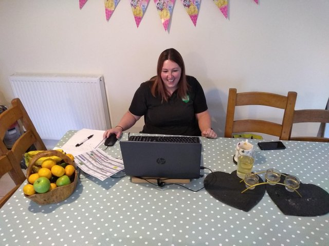 Hannah Beal, Family Dog Service Instructor at Dogs for Good pictured here doing a virtual session (photo from Dogs for Good charity)