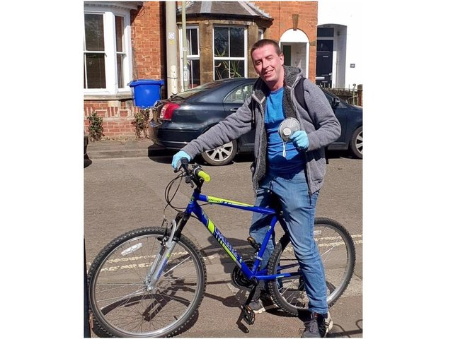 Michael Hampton, also known as Mike on a Bike, runs a volunteer delivery service of medicine and food packs to the vulnerable and isolating people in the community