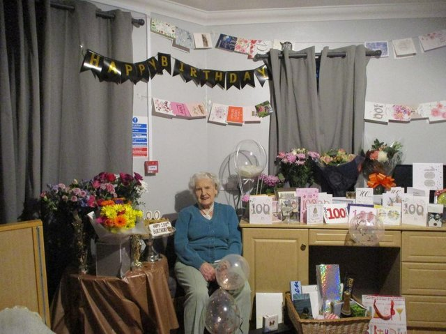 Mary Collier with her birthday cards marking her 100th birthday at the Glebefields care home in Drayton, Banbury (photo from Glebefields care home)