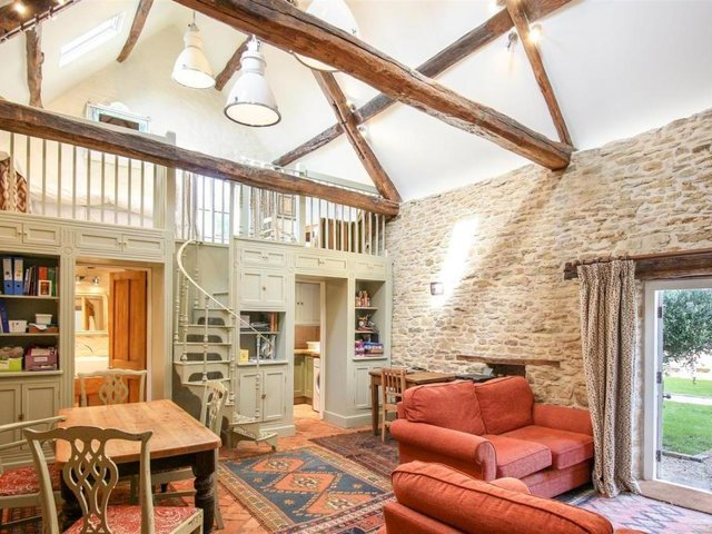 A living room inside the grade II listed property - the Abbey Lodge, which has come up for sale for £1.9m in Farthinghoe (photo from Rightmove)