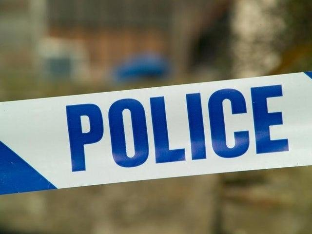 A suspected burglar was hospitalised after police say he jumped from a window at a building site in Banbury.