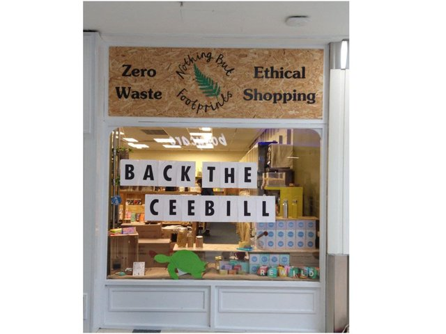 Banbury Quakers and members of Banbury Extinction Rebellion joined together in a national call for MPs to support the Climate and Ecological Emergency Bill (CEE Bill). Banner hung outside the business Nothing but Footprints in Castle Quay.