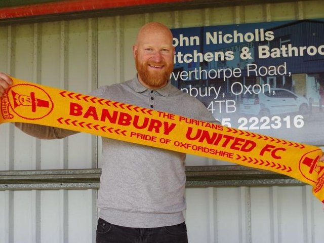 Andy Whing has signed a new deal to stay on as manager of Banbury United