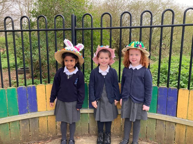 Three pupils - Gloria Rendage, 5, Sienna Standen, 5, and Florence Jones, 4 - from Harriers Academy Banbury wearing their decorated Easter bonnetts (Image from Harriers Academy Banbury)