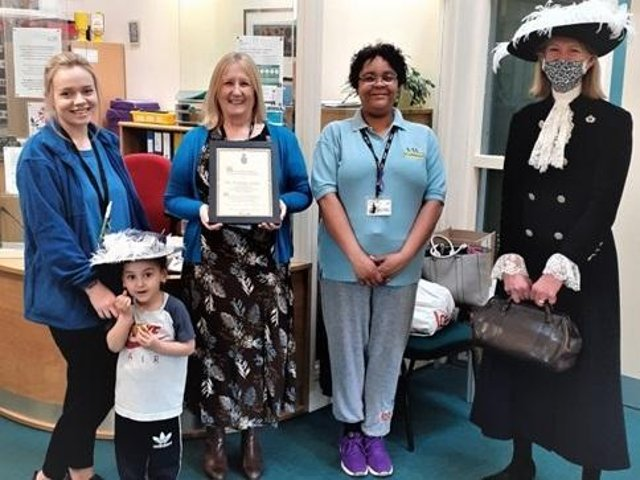Banbury's Sunshine Centre staff and children welcomed Amanda Ponsonby, right, for the presentation of the 'local treasure' award