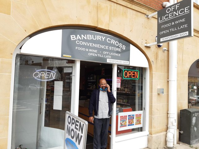 Gigi Mathew stands at the doorway of his business, the Banbury Cross Convenience Store
