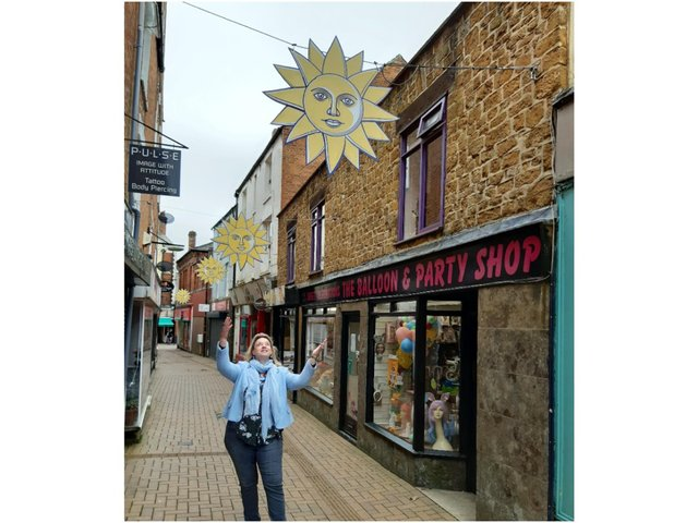 Yolanda Fletcher, the manager of the Banbury BID, points out some of the icons of Banbury BID the sunshine symbols placed around the town centre