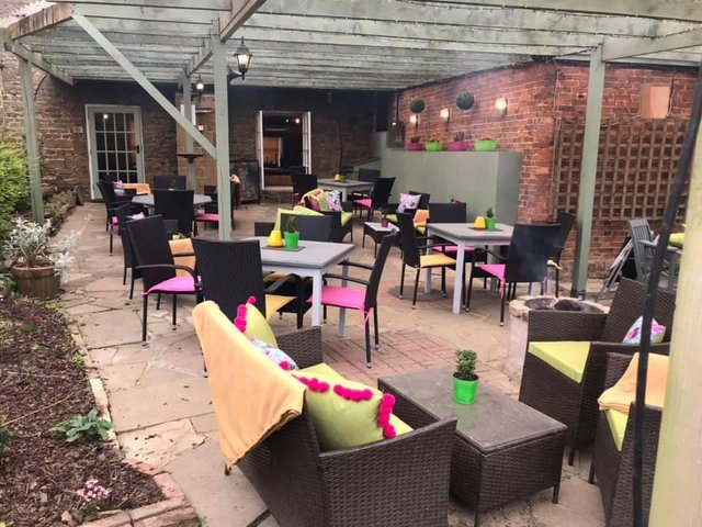 Outside seating area at The George Hotel pub in the village of Brailes near Banbury