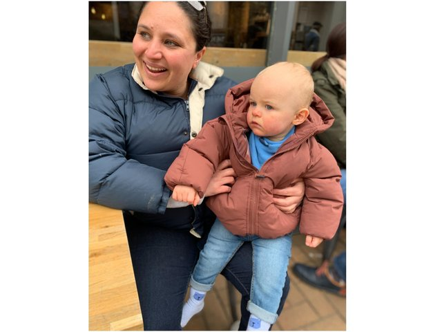Ezekiel Pip McNally, from Banbury, celebrated his first birthday on Friday April 16, pictured with Camila Machado, the midwife who helped deliver him.