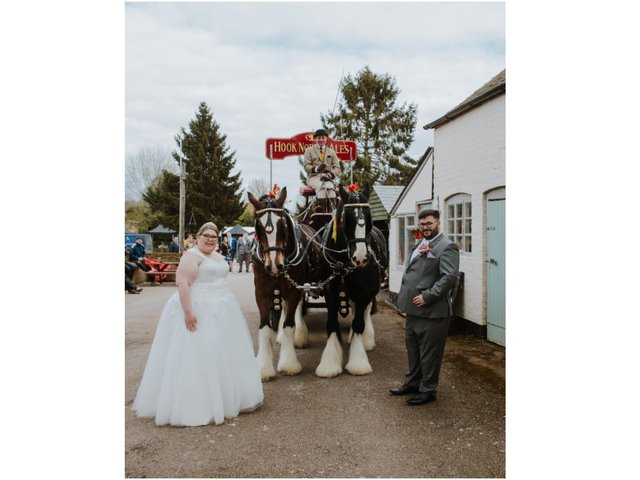 Kerry-May and Matthew Lord take part in the tradition of giving the horse a pint of Hooky beer (photo by Sam Bennett Photography + Film)