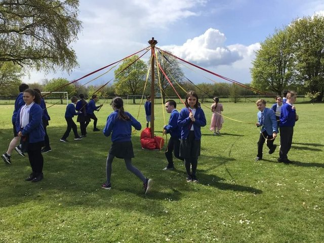 Pupils at Wroxton Primary celebrate May Day (Image from Wroxton Primary)