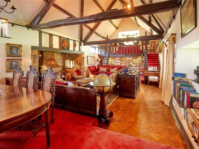 The 'Great Hall' at the grade II listed thatched homecalled Manor Houseis in the village of Sibford Gower near Banbury has come on the market (Image from Rightmove)