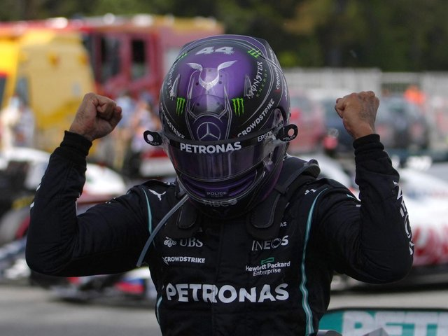 Lewis Hamilton celebrates his 98th GP victory