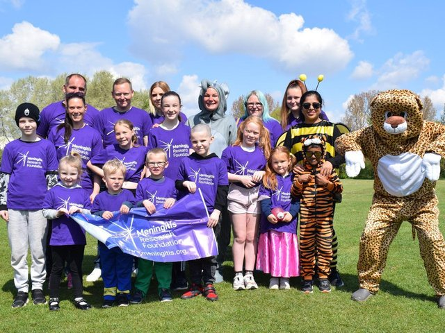 Kelly and Matt Hewitt teamed up with local hero Prabhu Natarajan and his family to complete 26 circuits of Spiceball Park to raise money for the charity,Meningitis Research Foundation.The group endured the challenge alongside family and friends dressed up in animal onesie costumes on Sunday, May 2.