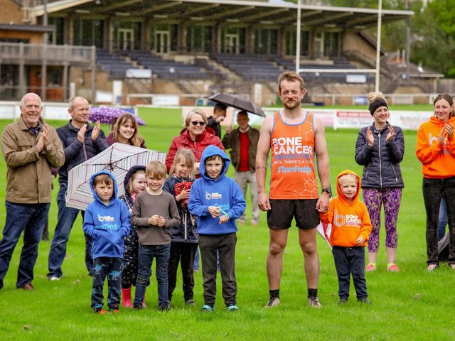 Rob Duffy is pictured, tired but happy, at the end of the run with Freddie, friends and families