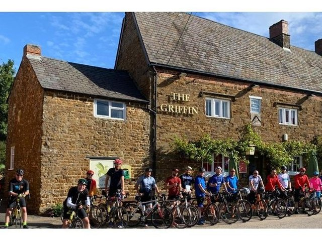 Cyclists who took part in last year's fund-raising ride are pictured outside The Griffin pub in Chipping Warden, which hosts the start and end of the event