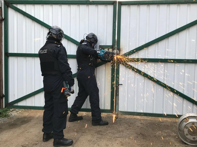 Thames Valley Police officers executing a warrant as part of an operation targeting organised crime and drug supply across the policing area, including Banbury (Image from TVP website)