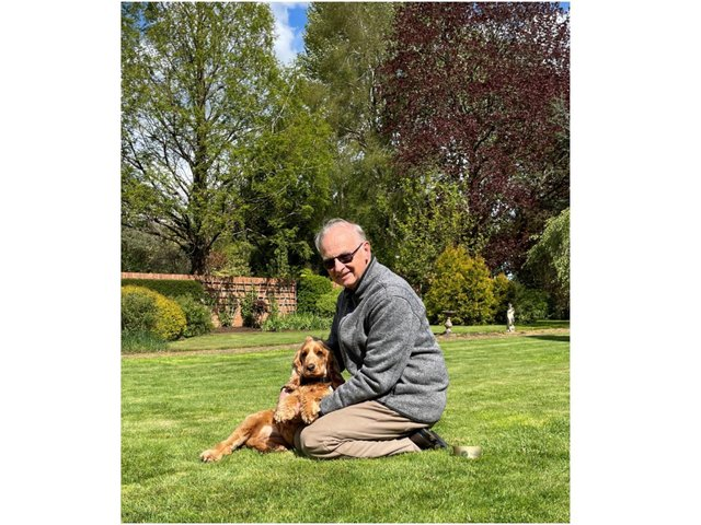 Gerry Bernardo, a volunteer with the Banbury-based charity Dogs for Good, is pictured with Esther, a 20-month-old cocker spaniel
