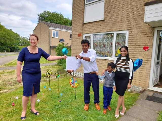 Banbury MP Victoria Prentis presents Prabhu Natarajan with his Points of Light award from the Prime Minister - pictured with his wife Shilpa Balachandran and son, Addhu.