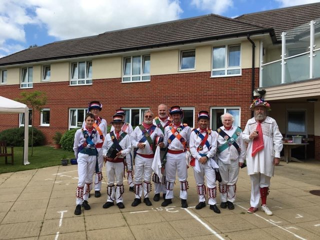 Residents and staff at Juniper House Care Home in Brackley recently welcomed back Brackley Morris Men to their gardens.