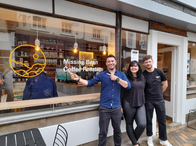 The Missing Bean coffee shop has opened in the Banbury High Street (Pictured: Staff members: Catalin Rusu and Laila Pipara and head of business development Silviu Rad.