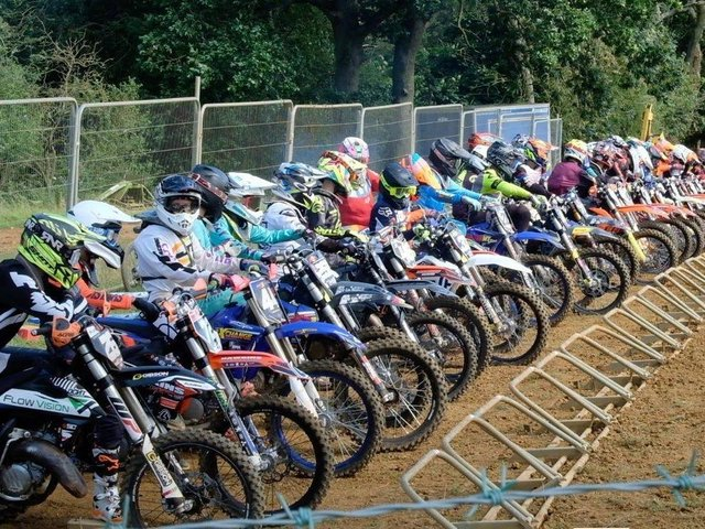 Motocross competitors line up at the start of a race at Wroxton