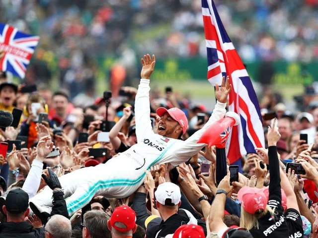 Lewis Hamilton celebrates with fans after winning the British Grand Prix at Silverstone in 2019 - the last one with spectators before the coronavirus pandemic. Photo: Getty Images