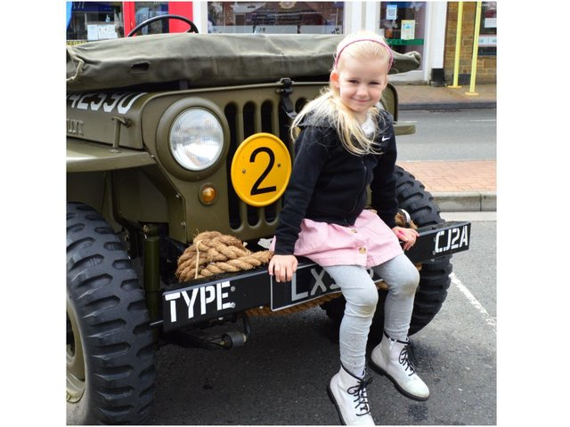 Darcie Embra-Barnes enjoys a seat on one of the exhibition jeeps. (Image from the Banbury Town Council)