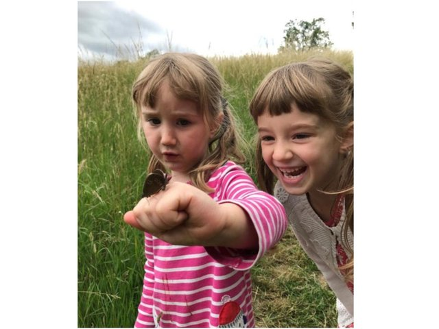 Children with a Hawkmoth - Beautiful charity butterfly walks are set to begin this week at Blackberry Farm near Shipston (Image submitted from the farm)
