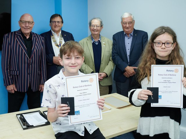 Finn Tibbetts and Hollie Hughes are pictured with their prizes. Also pictured are, from left to right, Harry Rhodes, David Richardson the Rotary President and Rotarians Tim Bryce and Ashley Bedding