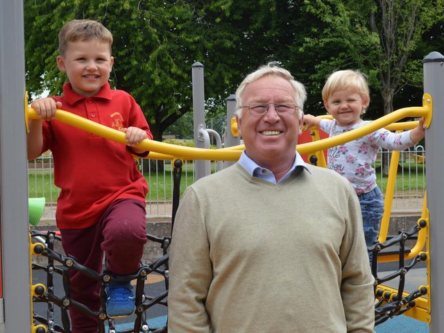 Ollie (3) and Becky (2) Buckle, who live locally, have been watching the new playground take shape and they were excited to try the climbing frame when they joined Cllr Colegrave at the opening. Photo from Banbury Town Council.