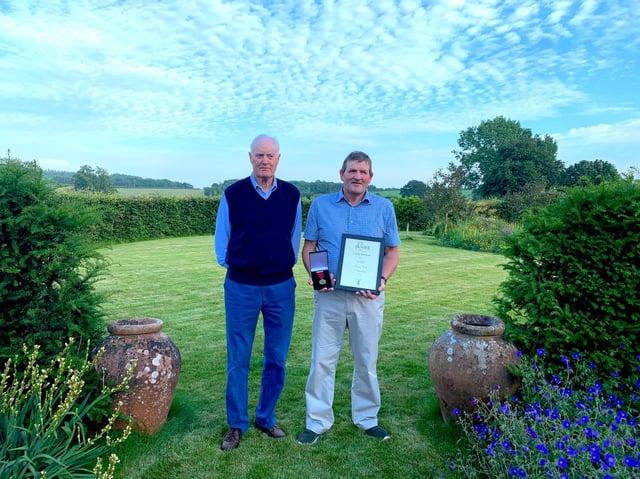 David Barnett, of Purston Lamb, and David Hill holding his long-service medal (photo from Purston Lamb and the Barnett family farm)