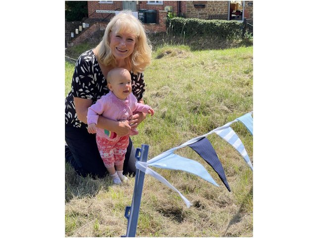Bobbie Brown shows her granddaughter 'Georgina' the bunting she made at the Bourtons' Big Bunting Bee project (submitted photo)