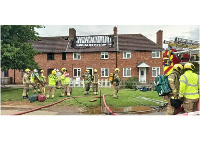 Northamptonshire firefighters tackle a house fire in the village of Byfield Monday afternoon (July 5) Image from @sailingbikeruk on Twitter.