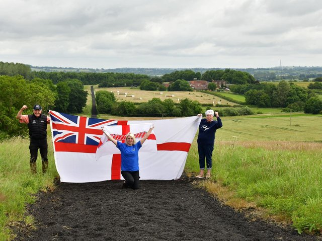 Team members of two local racehorse training teams (Paul Webber Racing & DAB Racing)held up flags at the top of the gallop at Cropredy Lawn showing their support for Englandahead of their EURO semi-final game (photo credit to Martin Archer)