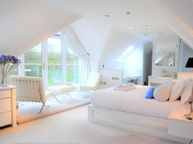 The master bedroom at the 10-bedroom home on the market near Shutford, Banbury (Image from Rightmove)