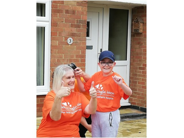 Rachel Jarrett, from Middleton Cheney, has raised £295 for Helen & Douglas House, by having her hair shaved off by Nathan, aged 9, who is cared for by the children's hospice. (submitted photo)