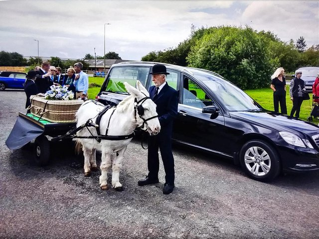 Banbury resident Malcolm 'the Donkey man'Weblin took his final journey ona London flatbed cart led by a little white donkey called Bobby. (photo by Tim Hill)