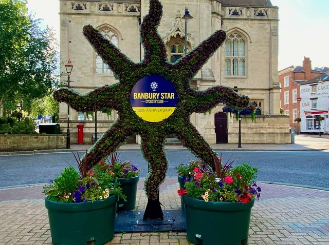 A floral display has been erected outside Banbury Town hall to help mark 130 anniversary of Banbury Star Cycling Club. (Photo from Banbury Star Cycling Club)