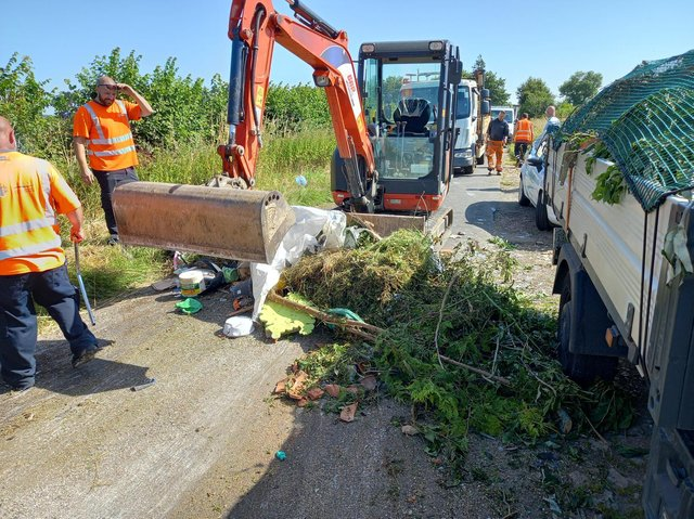 Officials from both Oxfordshire and Cherwell district councils helped clear up a major fly-tip which blocked a roadway near Bicester today, Friday July 16. (Image from Cherwell District Council Twitter)