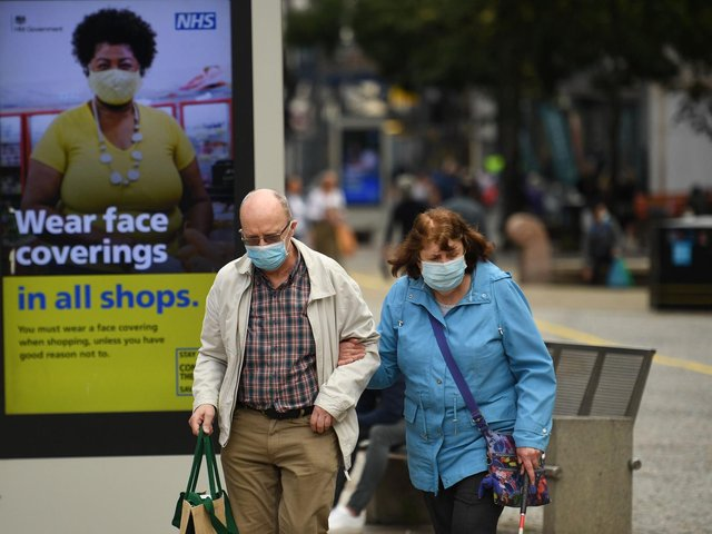 Restriction rules were relaxed today but in Banbury many shoppers still wore their masks. Picture by Getty